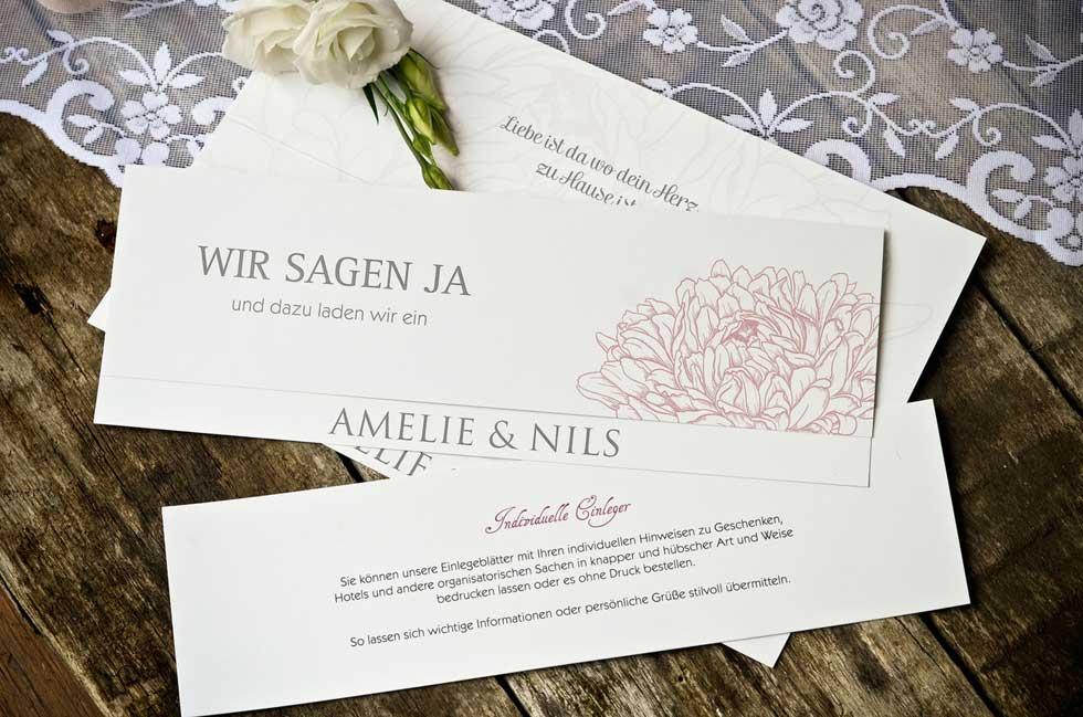 Einladung-zur-Hochzeit-mit-stilisierten-Blumen-in-Rosa-Amelie-und-Nils-carinokarten